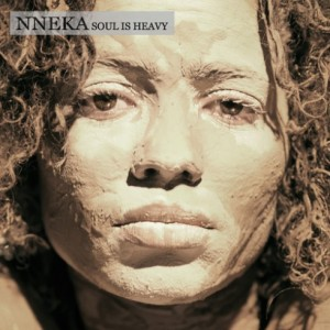 Nneka is a very hot artist! I admire that she is not contemporary and she has a very distinct voice. She can sing, rap, and do poetry- I'm all on board the Nneka train! I love her album cover for SOul Is HEaVy